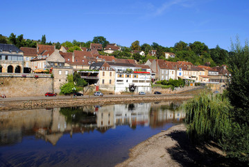 River Vezere in the market town of Le Bugue, France