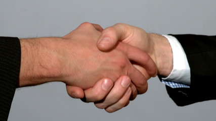 Men shaking hands on grey background