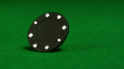 Black chip spinning on casino table