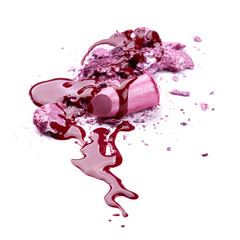 Crushed eye shadow, lipstick and nail polish isolated on white b