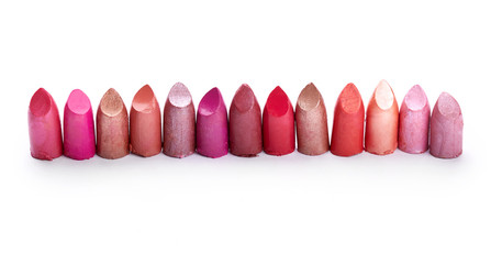 Lipsticks over white background