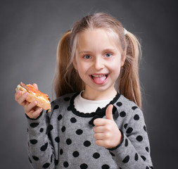 Happy little girl eating bread and butter with fish