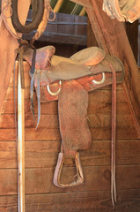 Old western saddle in a horse barn