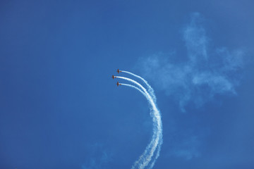 Three small sport airplane flying high in the sky