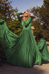 fashion photo of beautiful blond girl in elegant dress