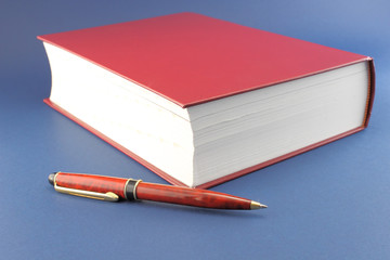 Pen and red book