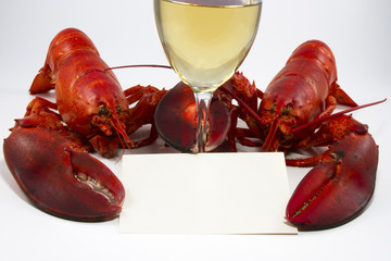 Two Lobsters with Menu or Recipe Card and Wine Glass