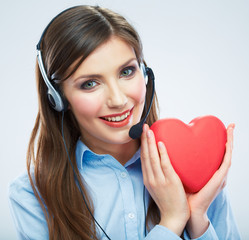 Woman call center operator hold love symbol Red heart. Close up
