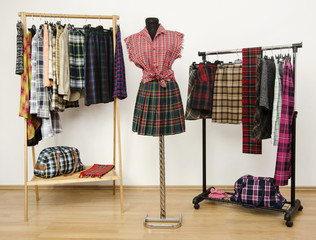 Wardrobe with plaid clothes and accessories on mannequin.