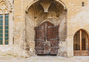 Old doors at Popes Palace in Avignon, France