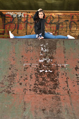 young beautiful dancer posing on a skate park