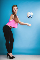 Young woman fashion girl with ball on blue background