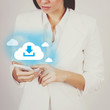 Businesswoman with smart phone downloading from cloud