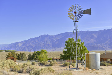 Vintage Water pump / Windmill in Rural landscape