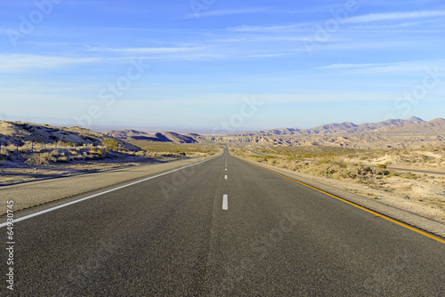 Driving on Remote Road in the Desert, Southwestern USA - 64930745