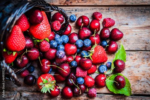 Fotobehang Vruchten Berries mix on rustic background