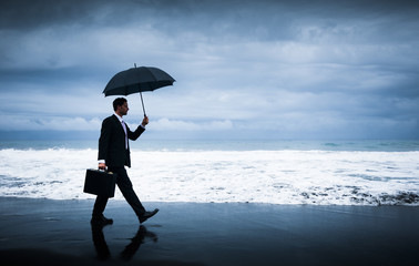 Businessman facing storm