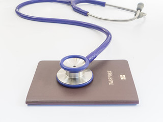 Close up stethoscope and passport
