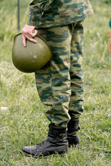 Soldier holding a helmet. End of hostilities