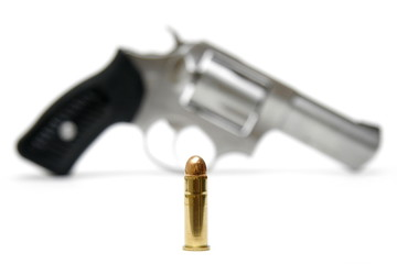 Silver Revolver And Single Bullet