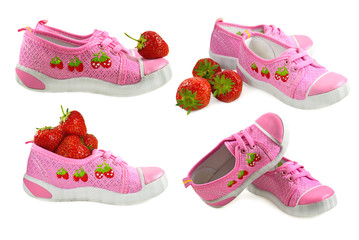 Kids shoes with strawberries isolated
