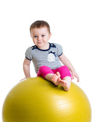 Kid having fun with  gymnastic ball isolated