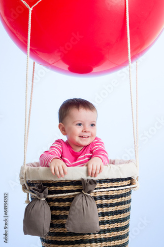 kid on hot air balloon in the sky