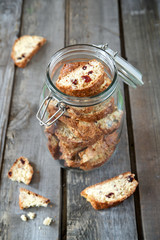 Biscotti with almonds and cranberries in a pot with a lid