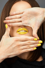 Woman face. Yellow nail. Blue lips.