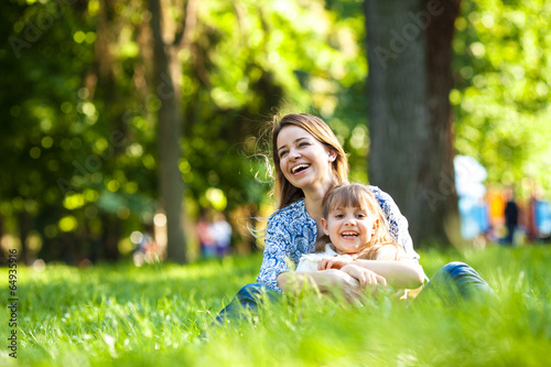 Mother and daughter relaxing in park.