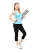 Attractive woman holding an exercise mat