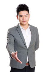 Asian Business man give hand