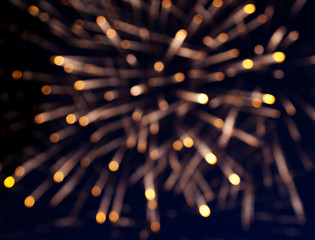 defocused image of fireworks, background with glares, holiday ba
