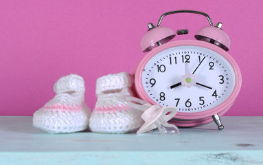 Baby girl nursery cute white and pink booties and clock