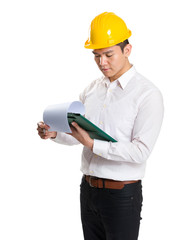 Surveyor reading on clipboard