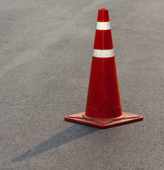 Grunge traffic cone with double white stripe on the street