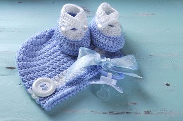 Baby boy nursery blue and white wool booties, dummy and pacifier