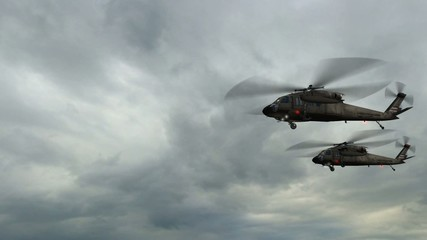Black Hawk Helicopter fly in storm clouds with lithning
