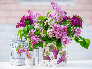 Beautiful still life with lilac and interior decoration details