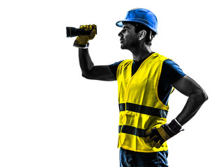 construction worker signaling with flashlight silhouette