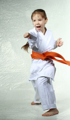 Girl with an orange belt beat blow arm