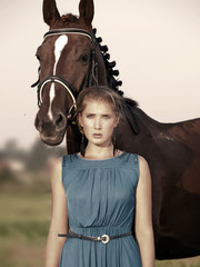 young beautiful  serious girl  with her horse