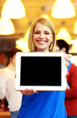 Smiling student showing tablet computer screen