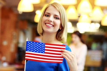 Happy girl holding flag of USA