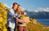 A couple with a basket full of grapes. Lavaux, Switzerland