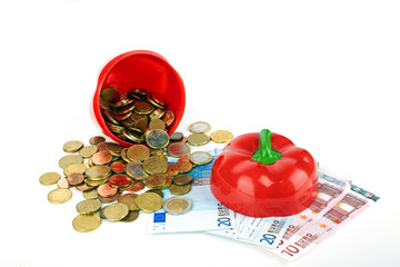 Health concept: Open red paprika with money