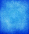 abstract blue background or dark paper with bright center spotli
