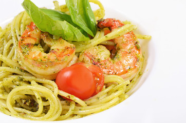 Spaghetti with sauce pesto and shrimps