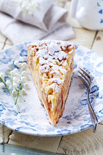 Piece of an Apple Cake Dusted with Icing Sugar