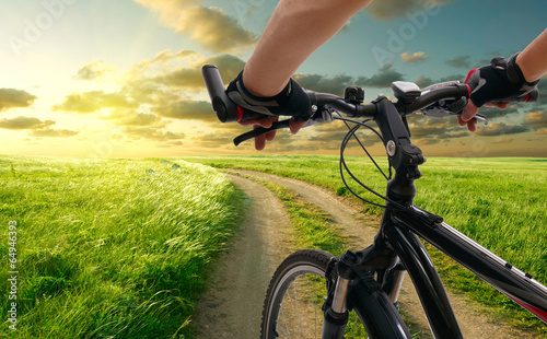 Poster Fietsen Man with bicycle riding country road